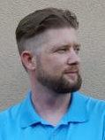 Headshot of author Daniel Kuhnley wearing a blue polo